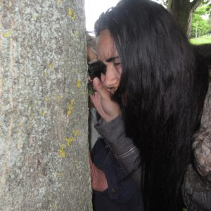 Inspecting Lichen with a field magnifier